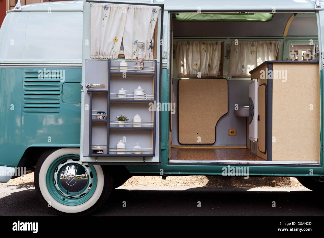 Side view with open door of a Volkswagen VW campervan - Stock Image