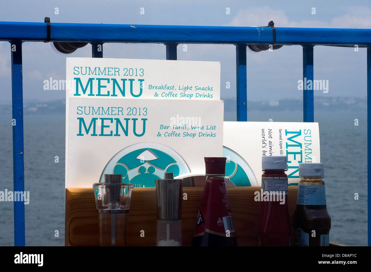 summer menu,Fishtown,Brixham,beach, dock, boating, docking, boat, lake, fishing, old, rowboat, rowing, row, water, - Stock Image