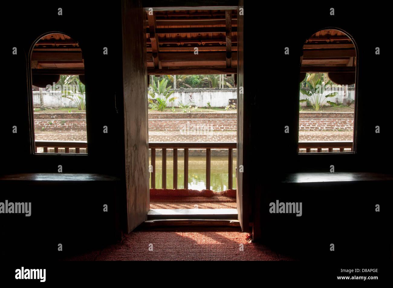 View through windows, door of old building - Stock Image