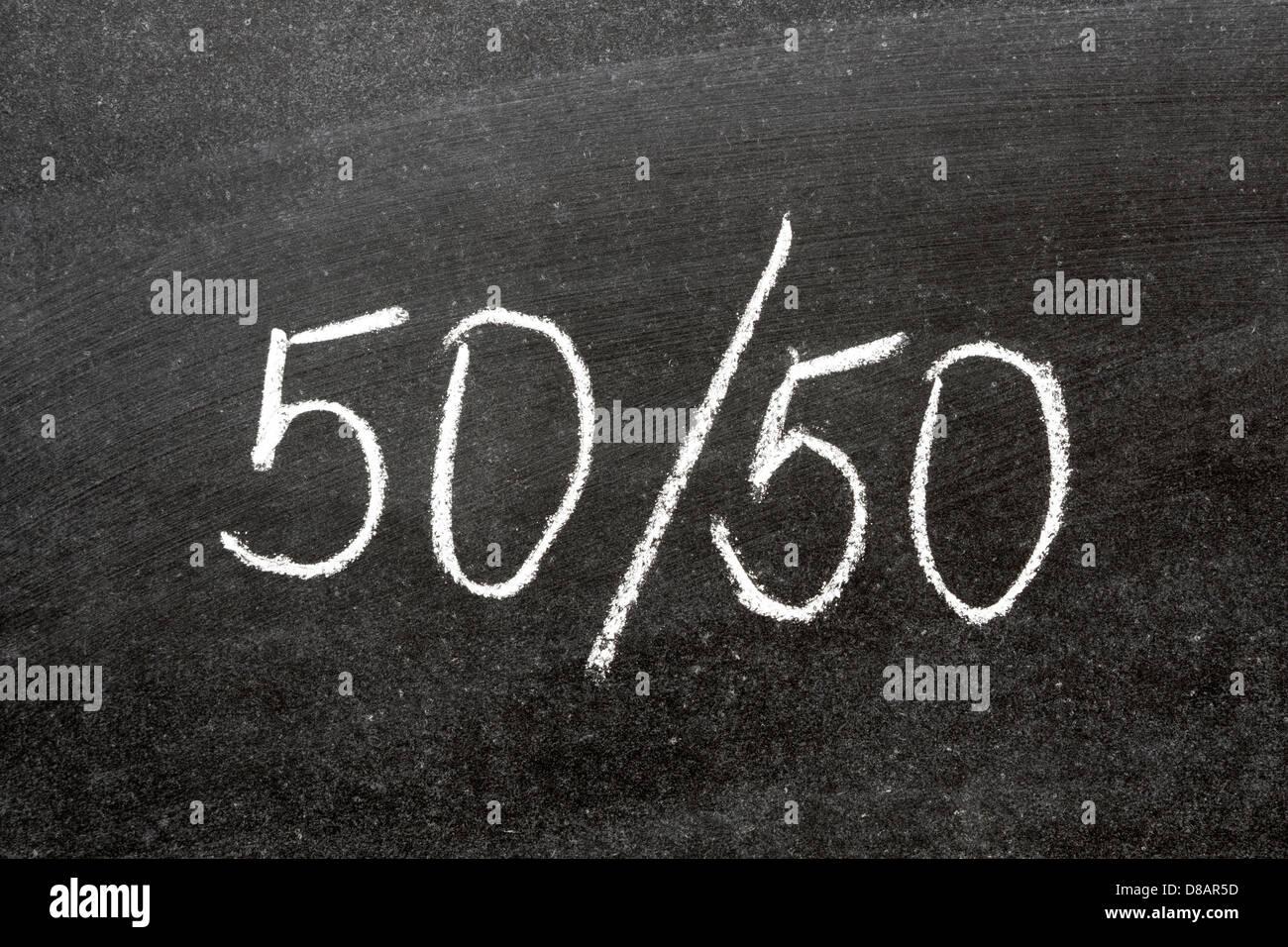 simple fifty-fifty ratio handwritten on blackboard - Stock Image
