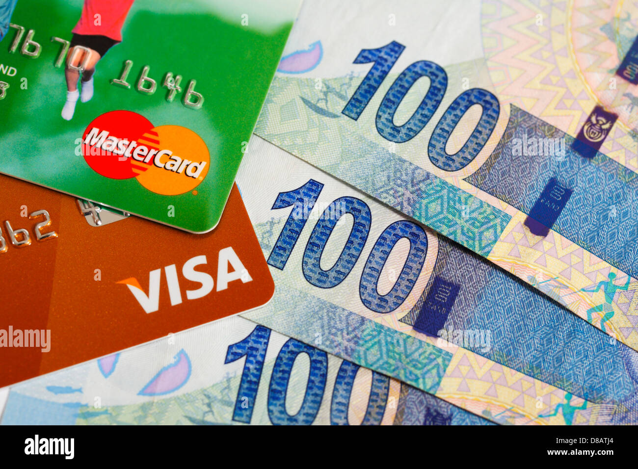 A Visa and Master Card with South African rands currency - Stock Image