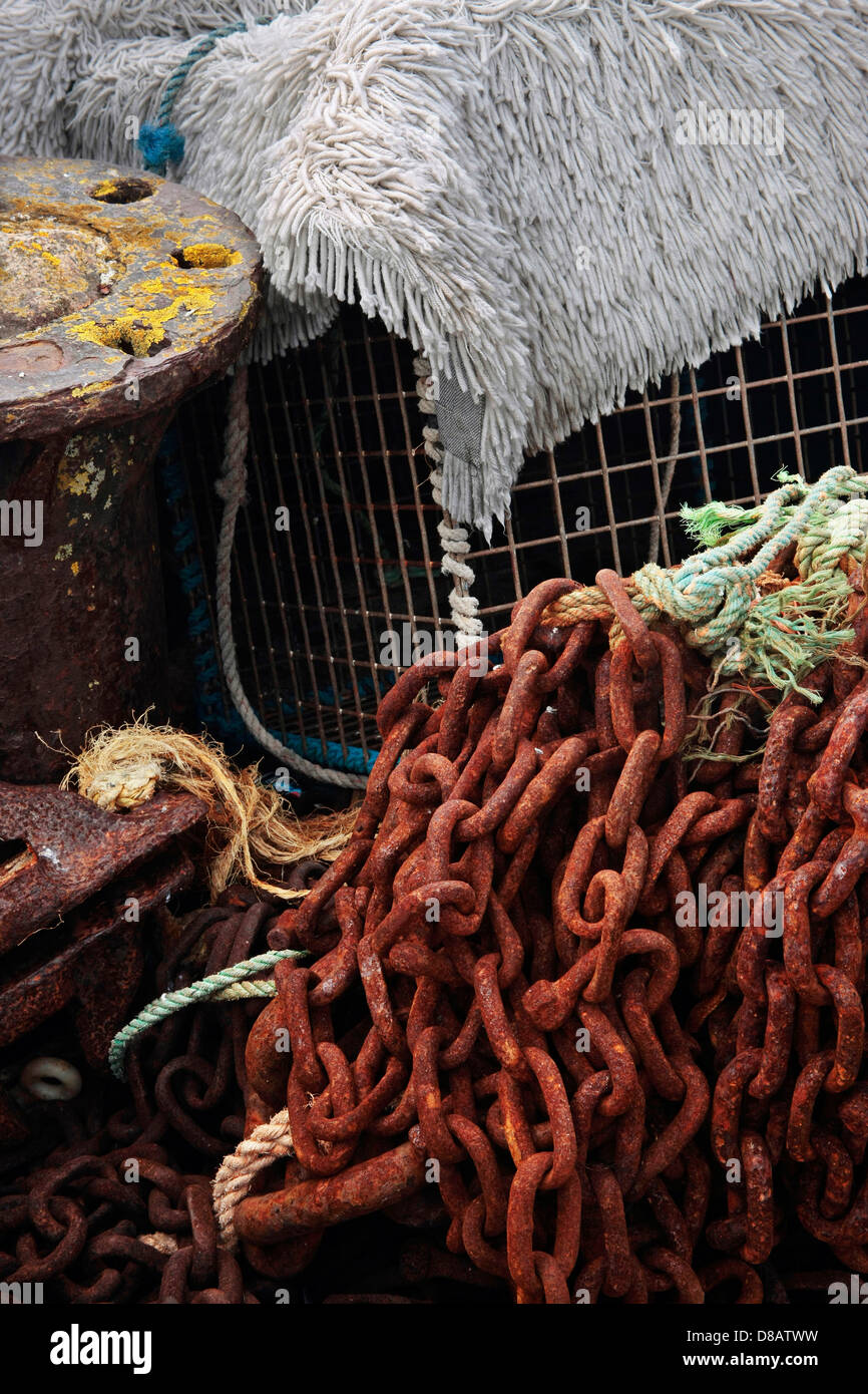 Rusty chains and cab pots habour wall St Ives - Stock Image