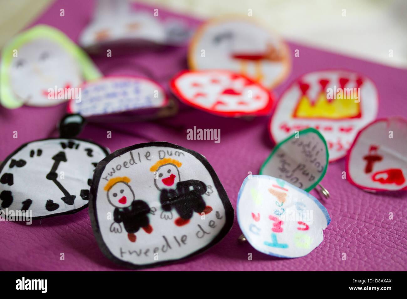 badges made by 7 to 8 year old child using, paper pens and glue, handmade at home - Stock Image