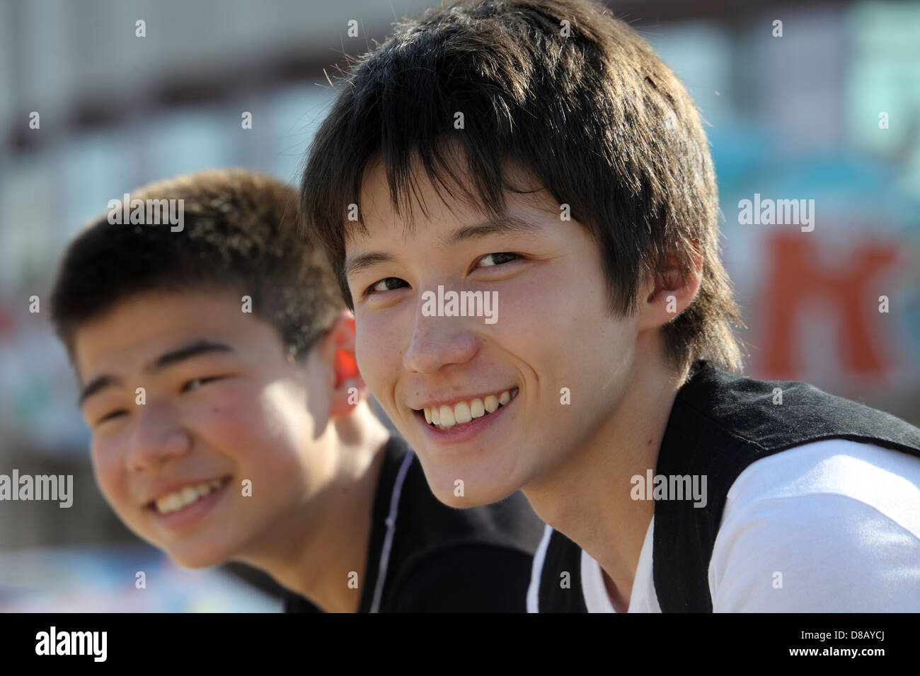 Kazakh boys teen-ager with smile on the faces - Stock Image