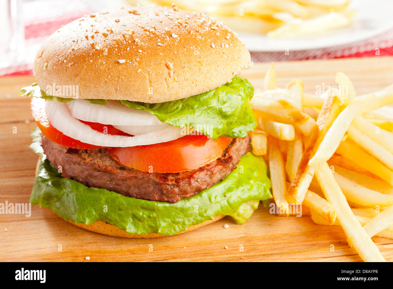 Homemade Organic Hamburger with Lettuce and Tomato - Stock Image
