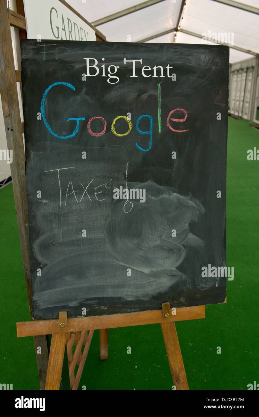 chalkboard outside google big tent were someone has written taxes at hay festival hay on wye powys uk