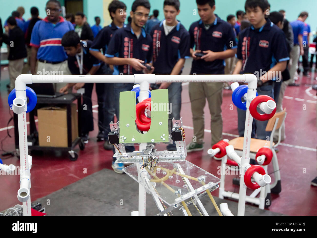Multi Ethnic Group Of High School Robotics Club Students Give A