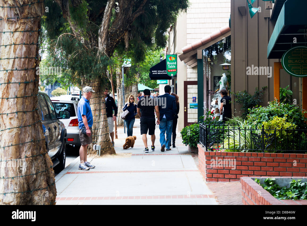 Locals And Tourists Walking On The Sidewalk In Downtown Los Gatos,  California.