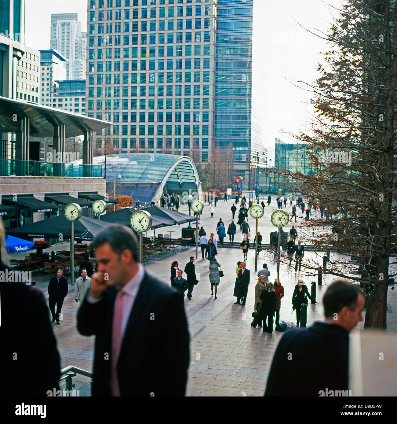A businessman talking on mobile phone during 2008 banking crash in Canada Square Canary Wharf financial district - Stock Image