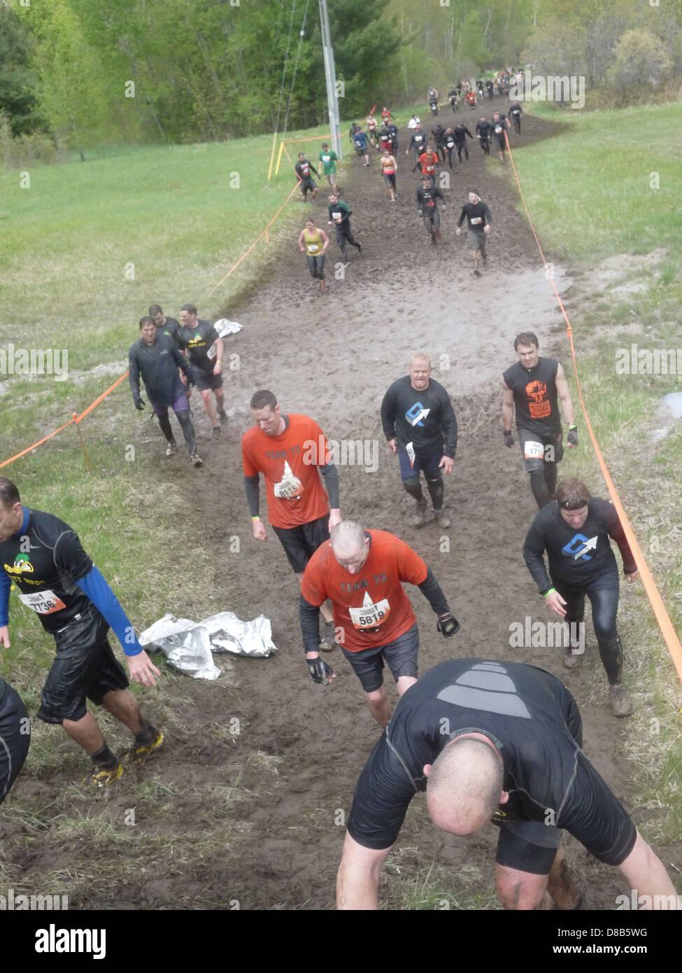 people walking mud road 'tough mudder' - Stock Image