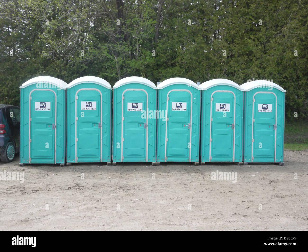 Portable Toilets Row Green Outdoor Restroom