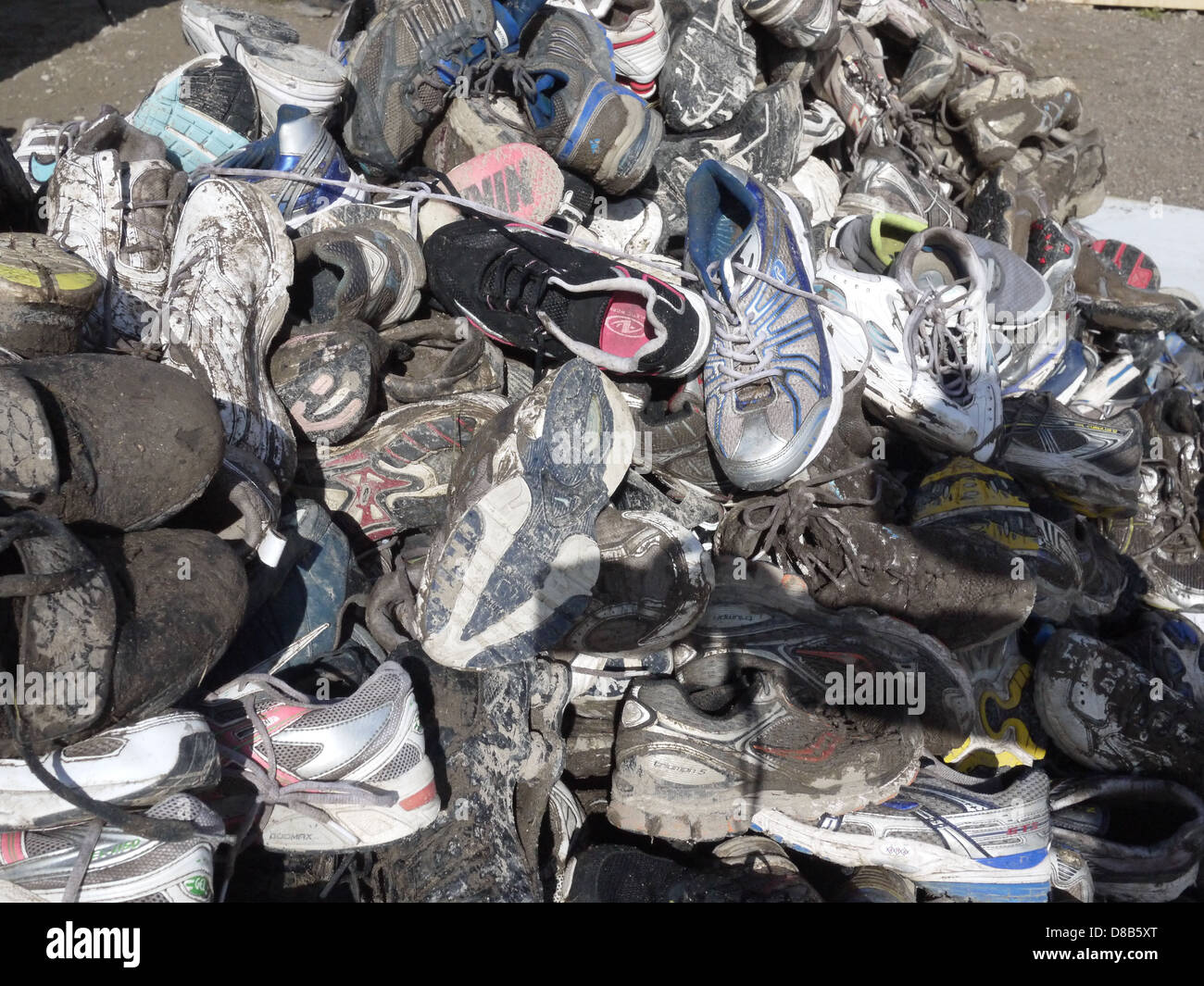 dirty muddy shoes landfill - Stock Image