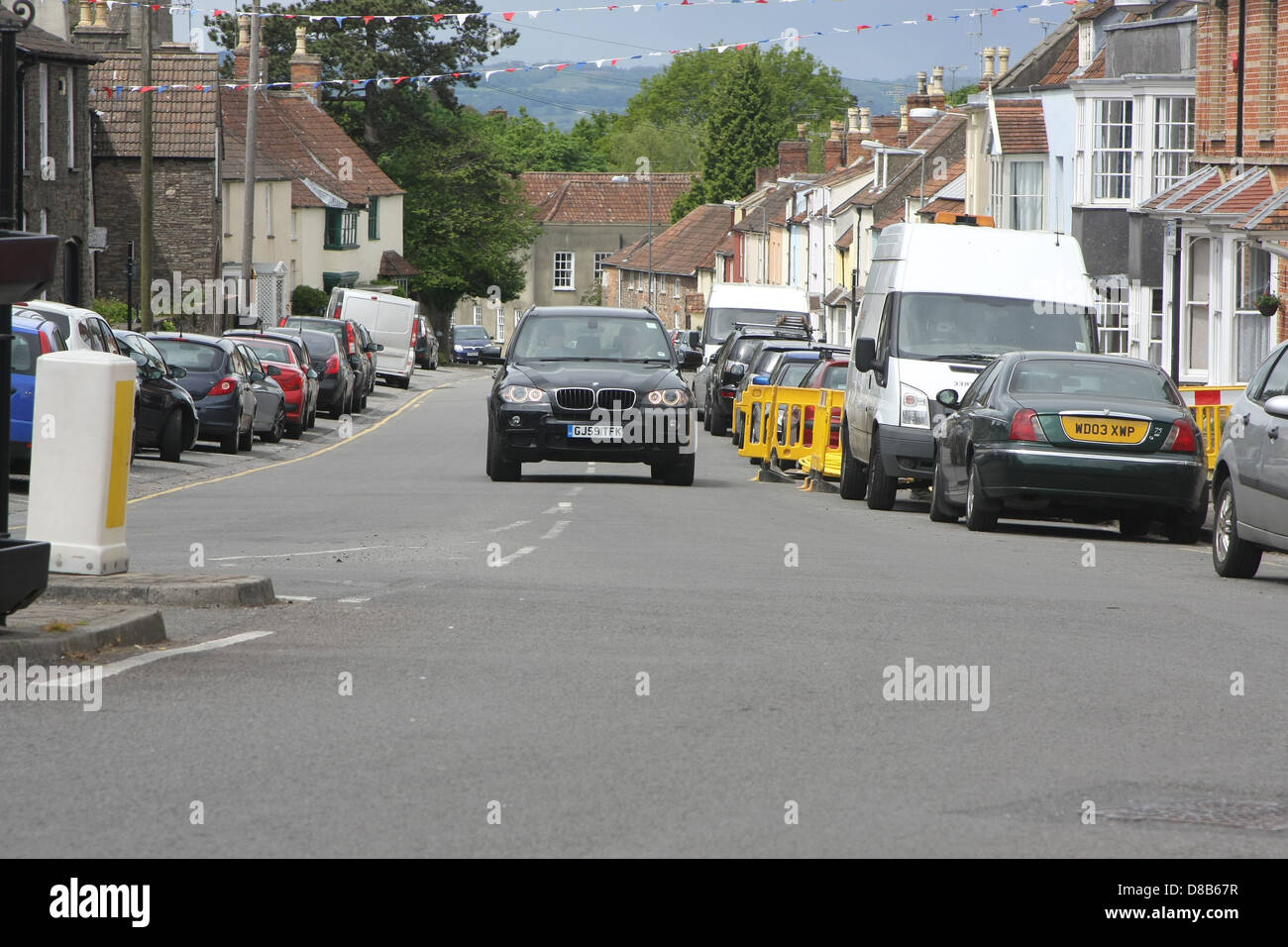 Main road through Thornbury with a black BMW X5 approaching. May 2013 - Stock Image
