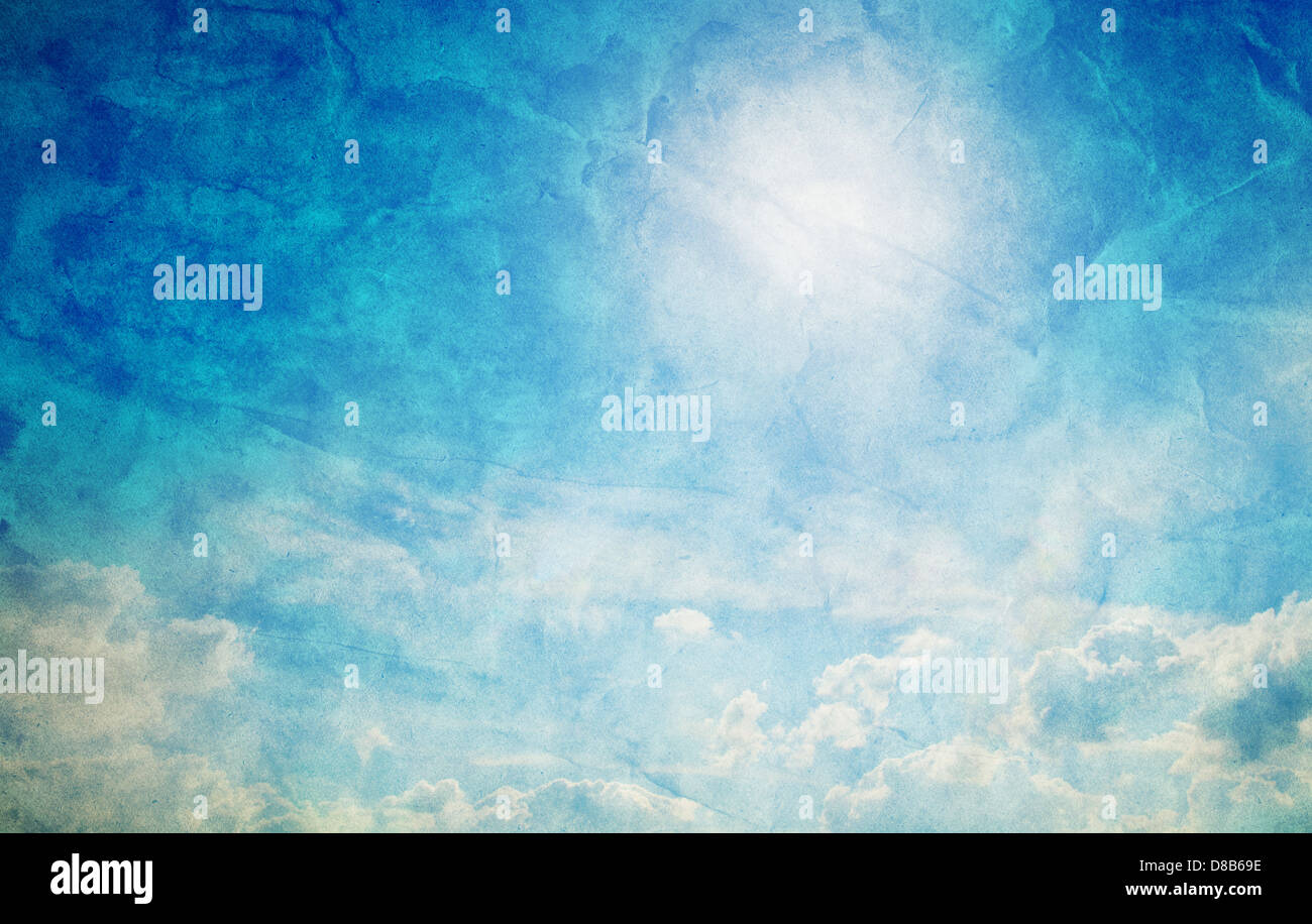 Vintage, retro image of sunny blue sky with puffy clouds. Grunge and creased canvas texture - Stock Image