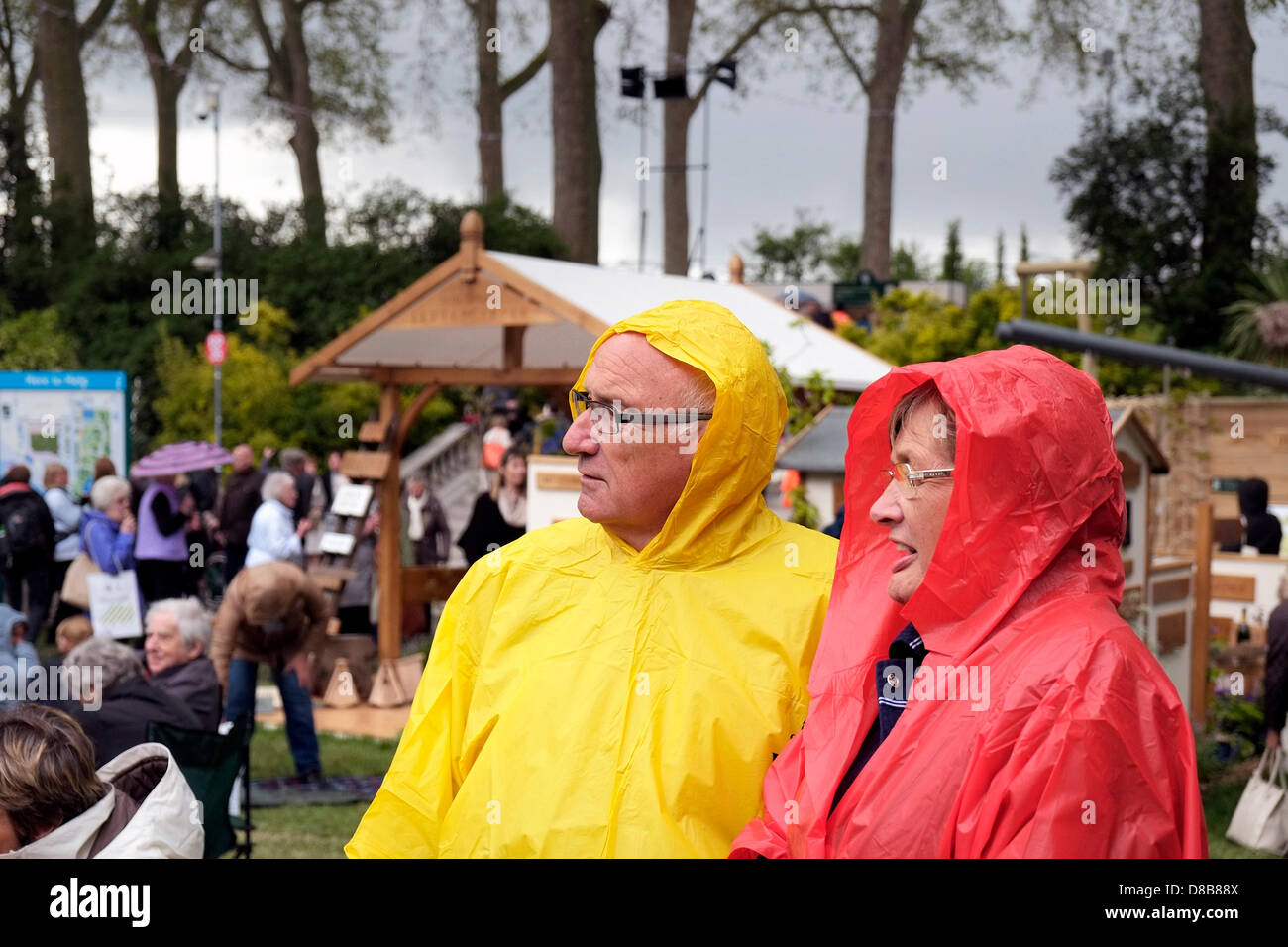 London, UK. 24th May 2013. Members of the public brave the wet and cold conditions at the centenary Chelsea Flower - Stock Image