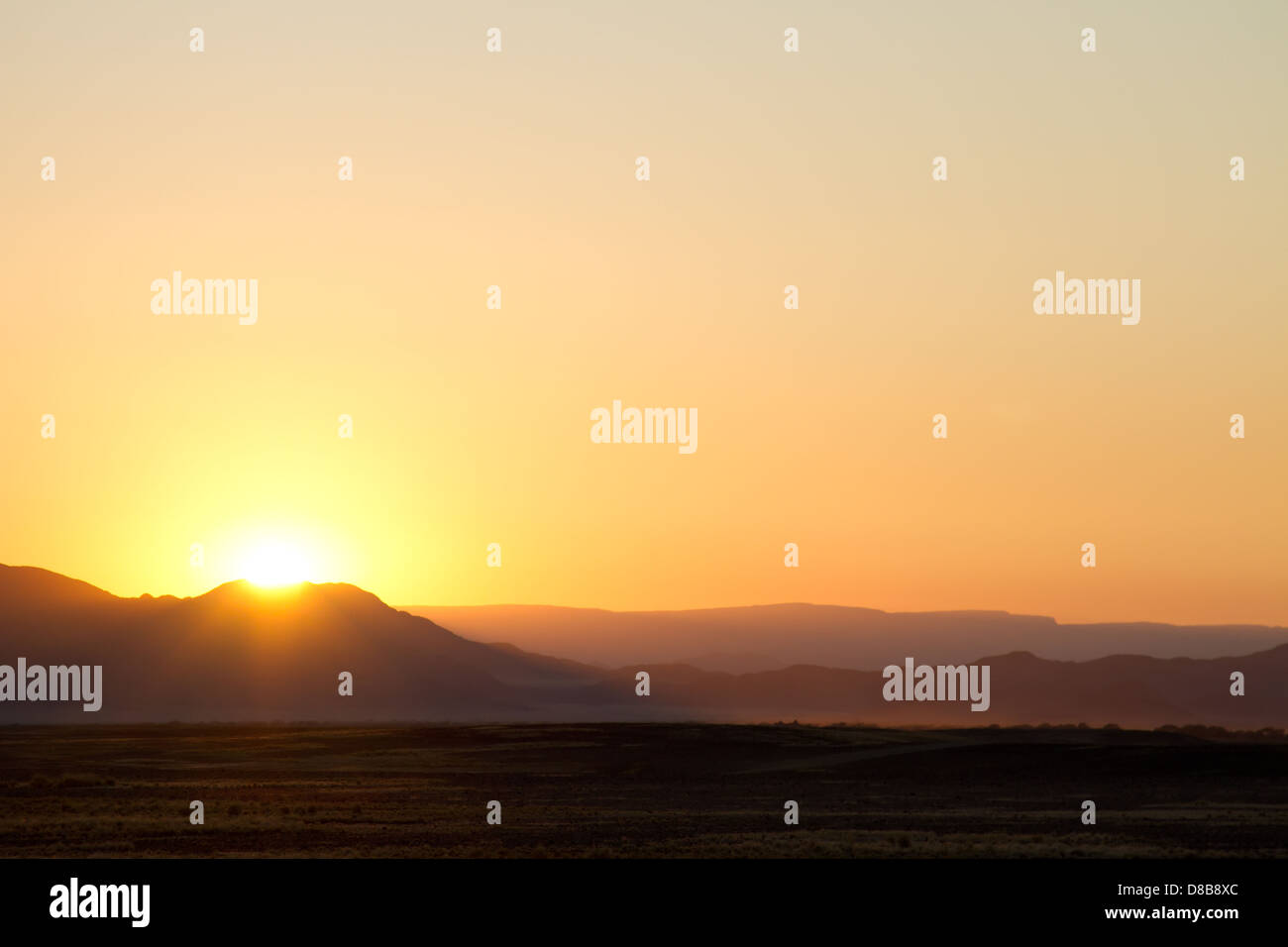 Sun rise over the mountains Sossusvlei Namibia - Stock Image