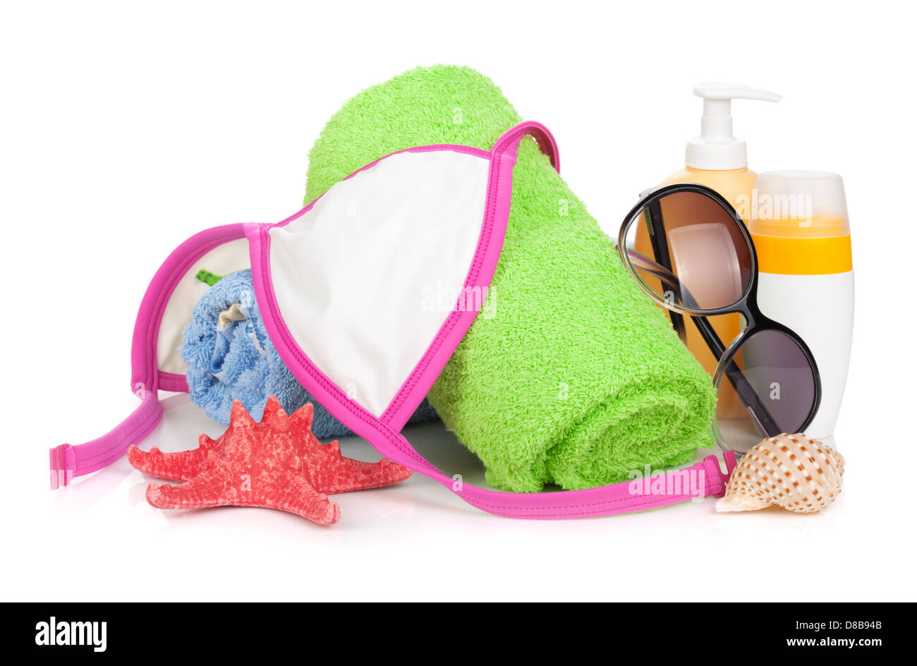 Swimming suit and beach items. Isolated on white background - Stock Image