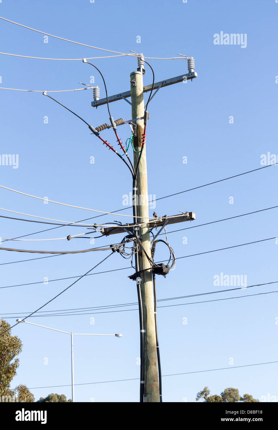 Overhead Electrical Conductors : Three phase overhead electrical distribution poles and