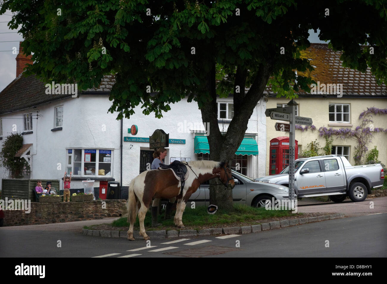 Kentisbeare village centre, Devon with ponies, village stores and post office and red telephone kiosk - Stock Image