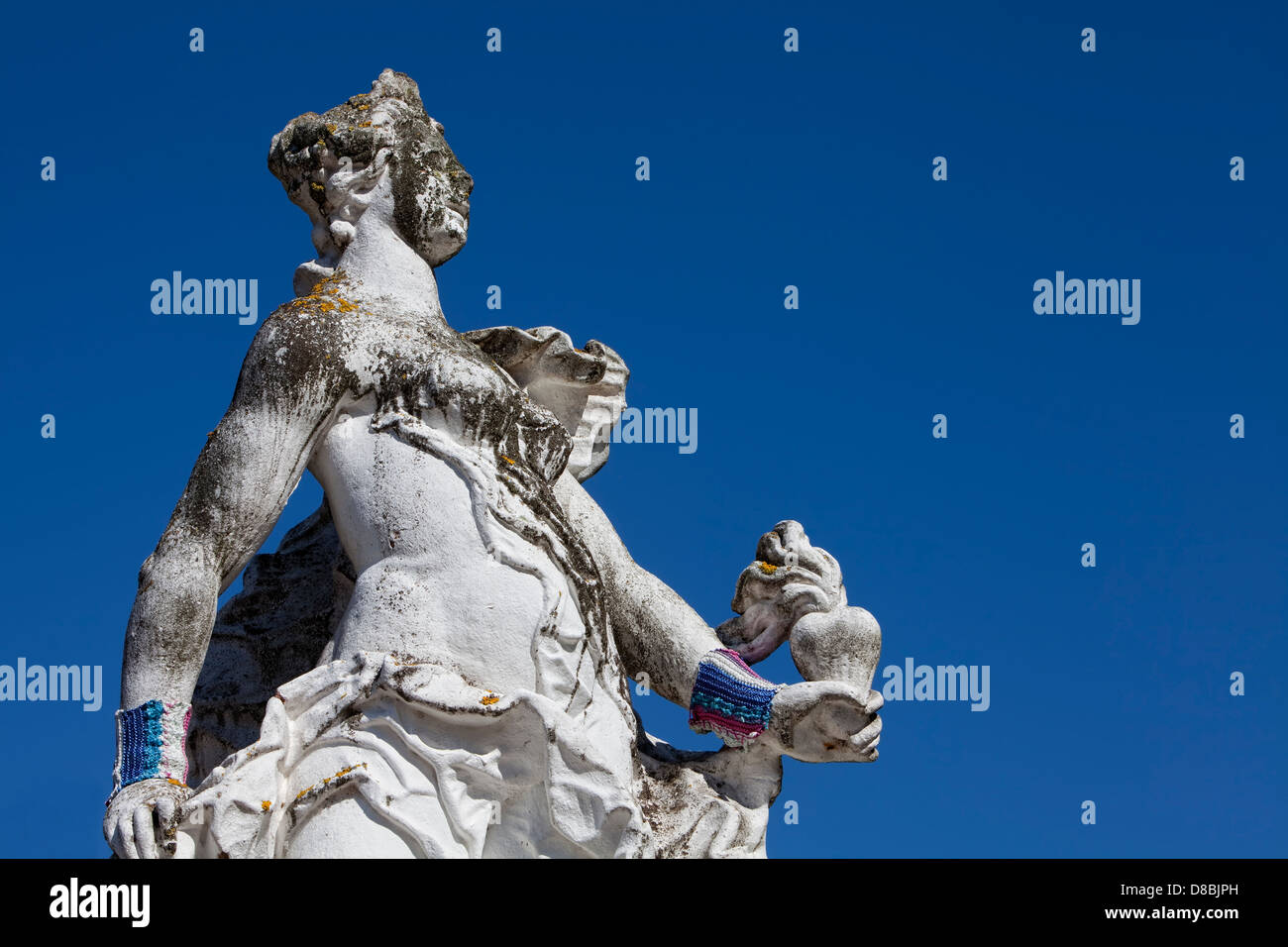 Baroque statue wearing a hand knitted wrist warmer in front of the Electoral Palace in Trier, Rhineland-Palatinate, - Stock Image