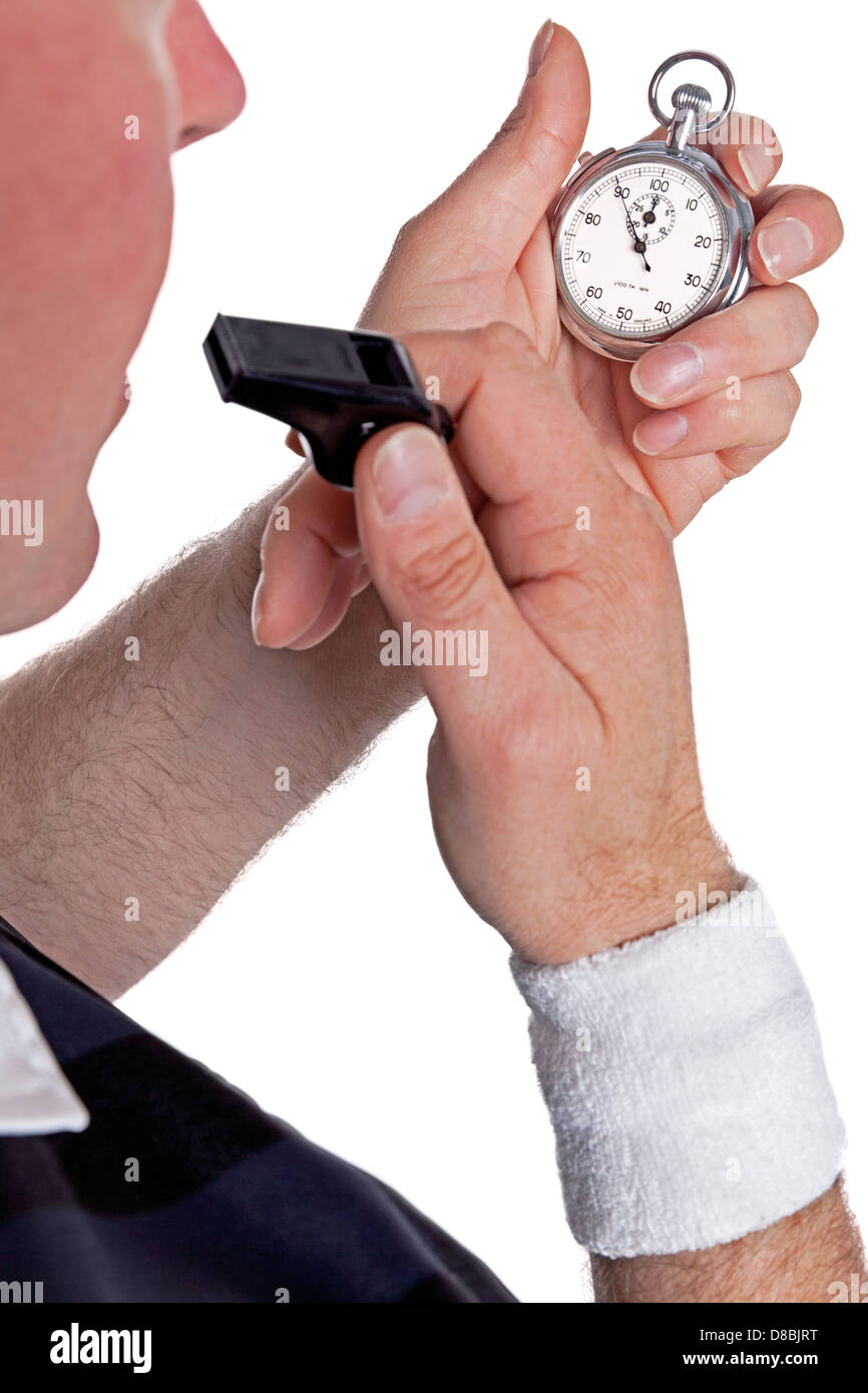 A referee checking his stopwatch and about to blow the whistle, isolated on a white background. - Stock Image