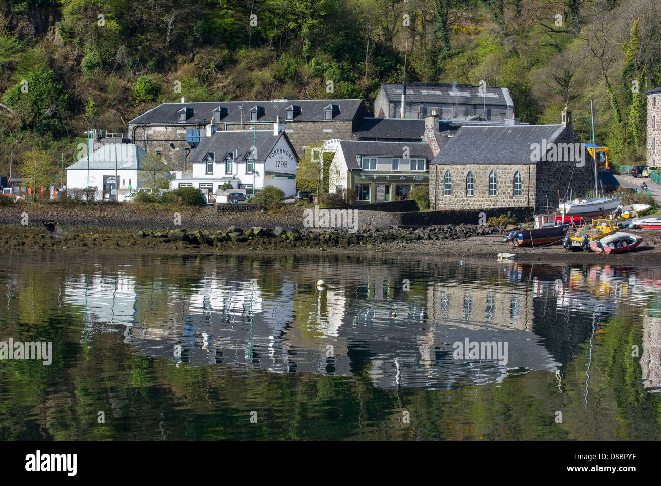 View of the Harbour at Tobermory. including the distillery - Stock Image