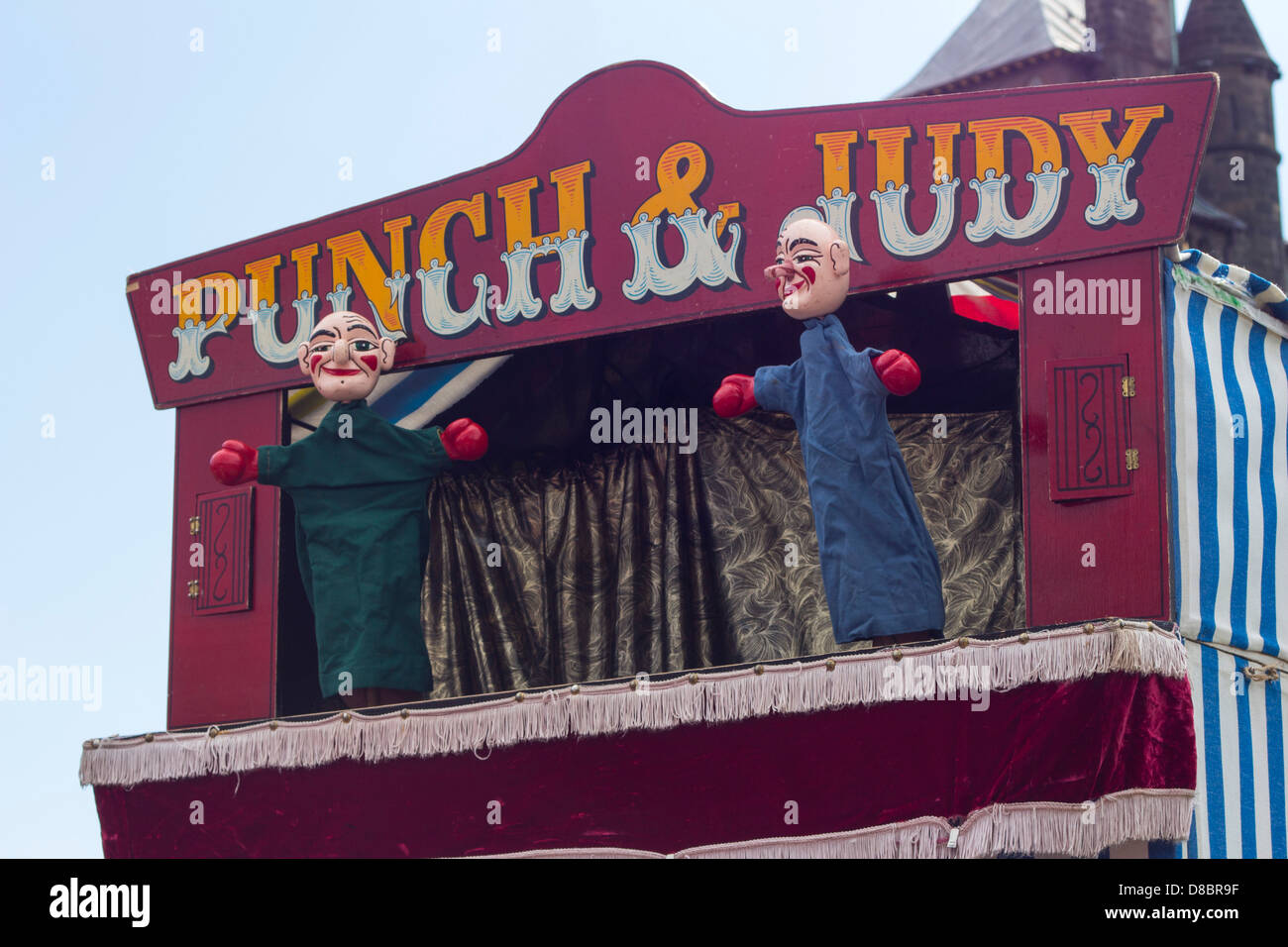 A Punch and Judy show boxer's interlude. - Stock Image