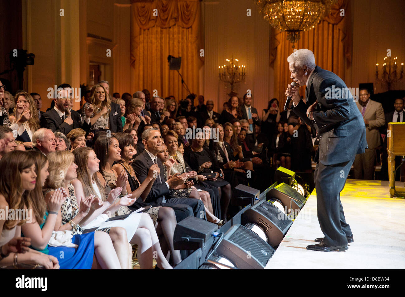 US President Barack Obama and First Lady Michelle Obama, along with daughters Malia and Sasha, listen as Eddie Floyd - Stock Image