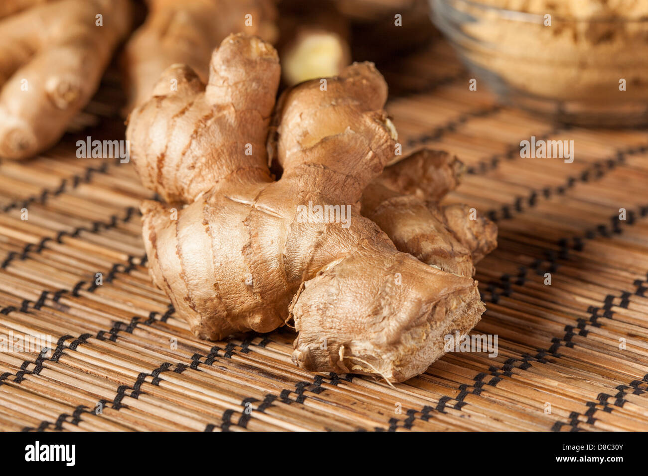 Fresh Organic Oriental Ginger on a background - Stock Image
