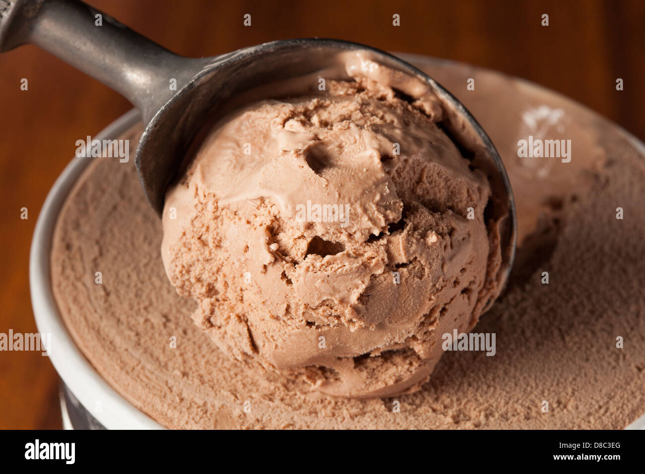 Cold Organic Chocolate ice Cream against a background - Stock Image