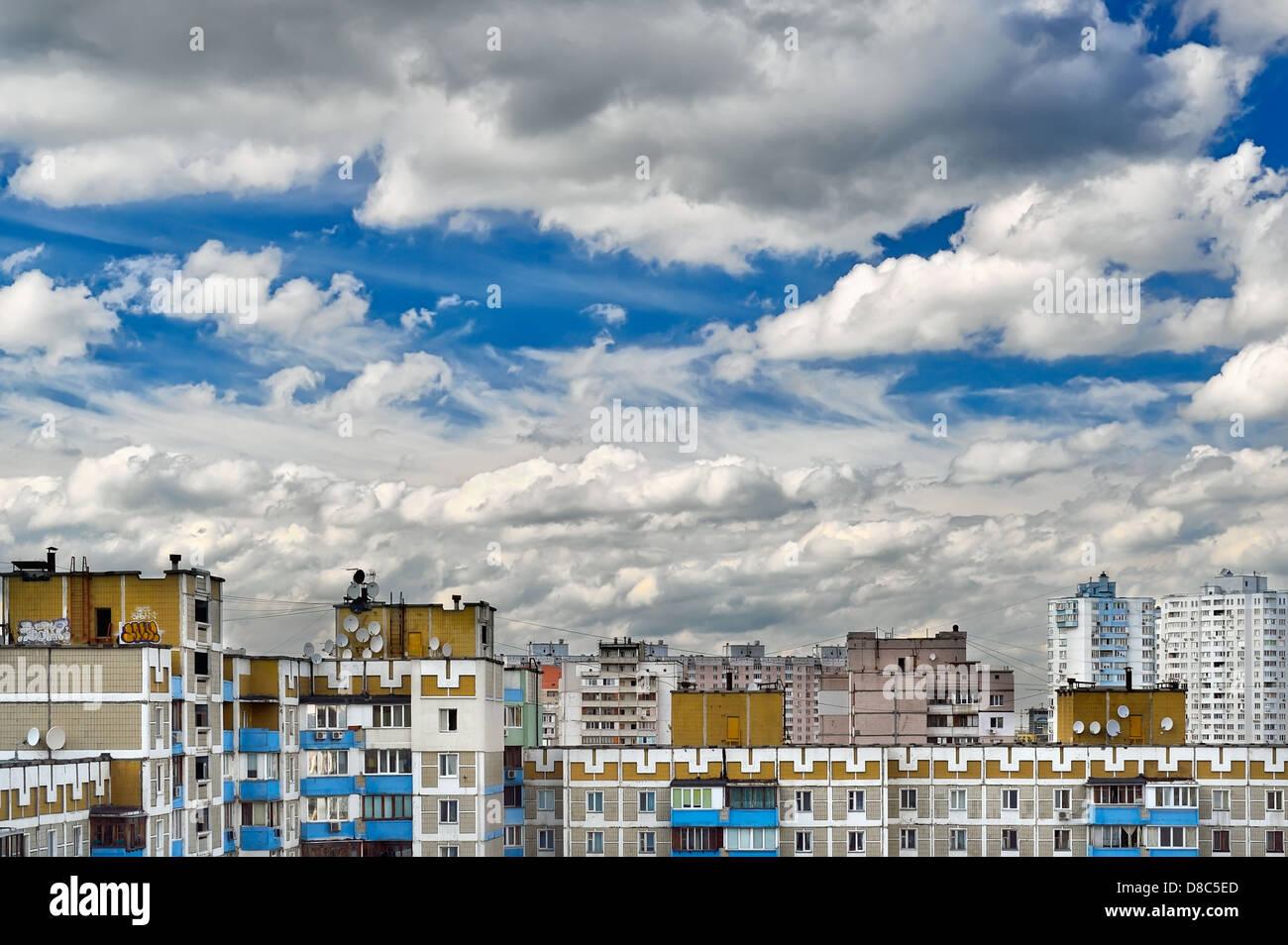 Dramatic cumulonimbus clouds on blue sky over cityscape. Kiev, Ukraine - Stock Image