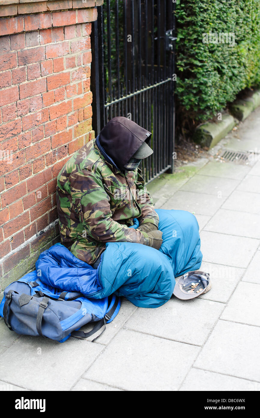 homeless man sitting down begging for money  on the Streets of Salisbury - Stock Image