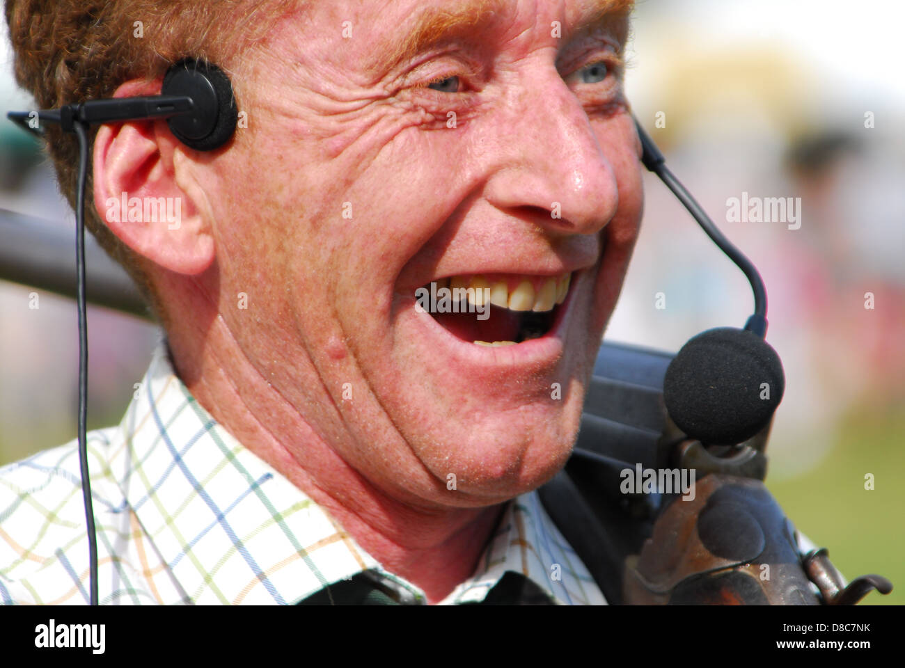 Laughing Commentator - Stock Image