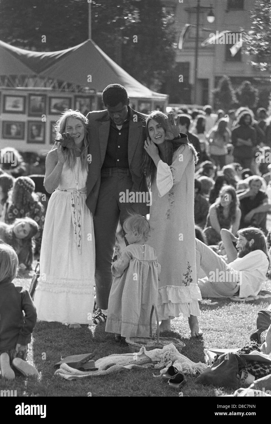 hippies and concert fans  dance and party at sixties art and rock music festival in North Beach San Francisco - Stock Image