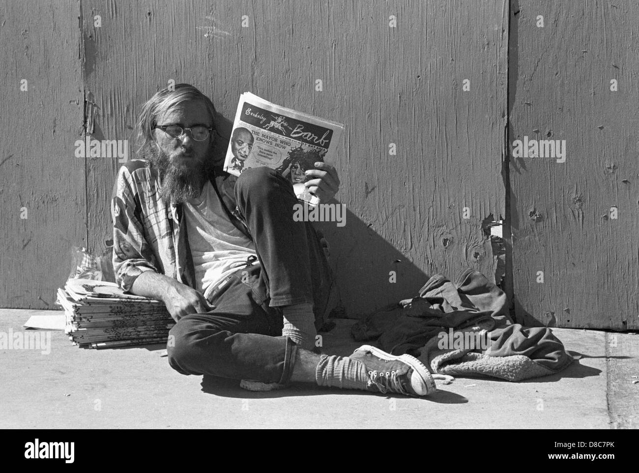 hippie drop out sells sixties underground counterculture newspaper the Berkely Barb - Stock Image
