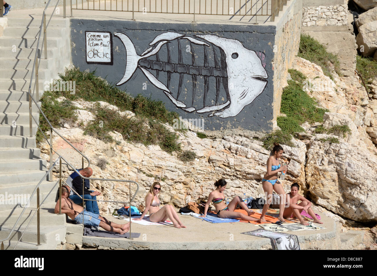 Sunbathers on the Seafront at Endoume or Malmousque Marseille France - Stock Image