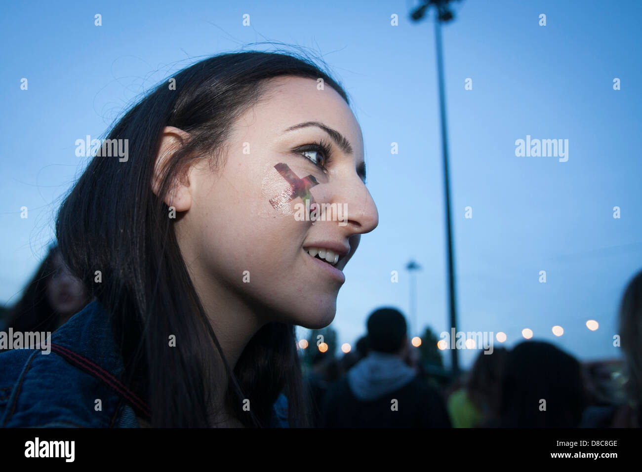 Fan of The XX with an X drawn on her face at the Night and Day festival, in Lisbon, Portugal. - Stock Image