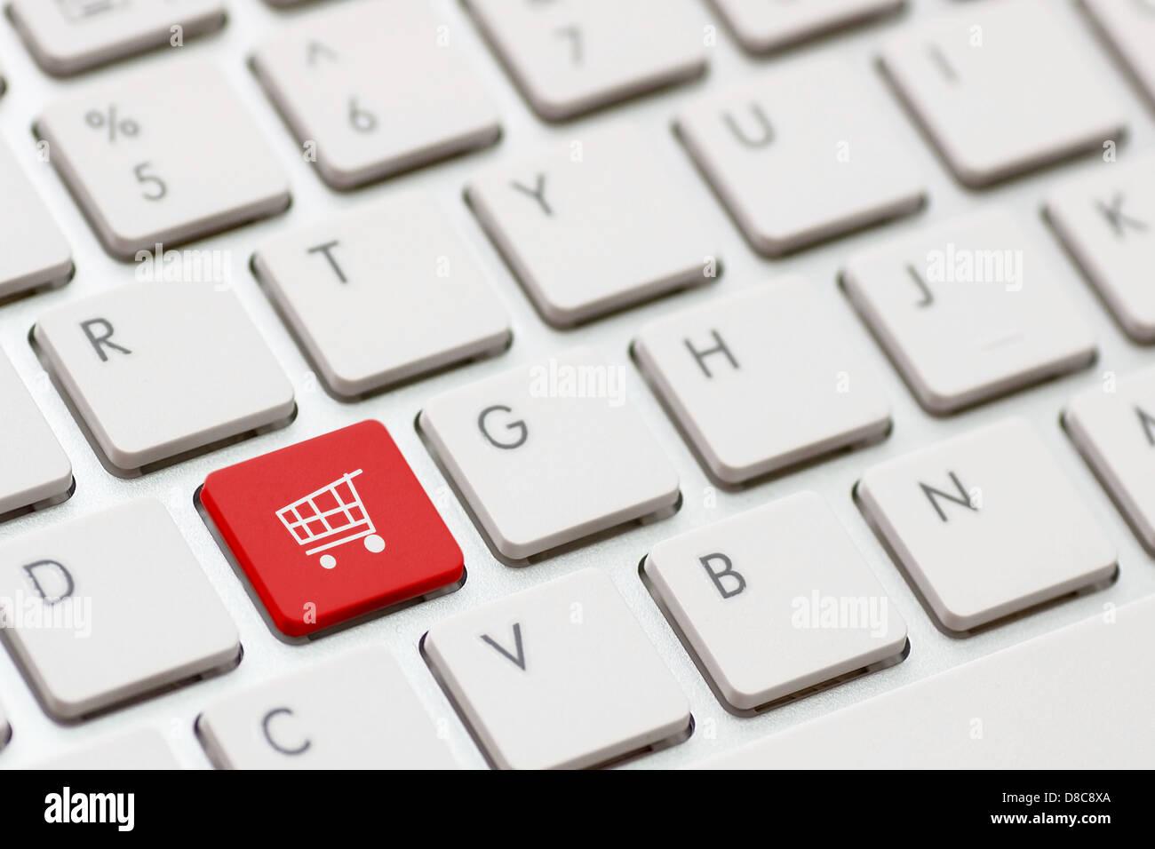 shopping enter button key on white keyboard Stock Photo