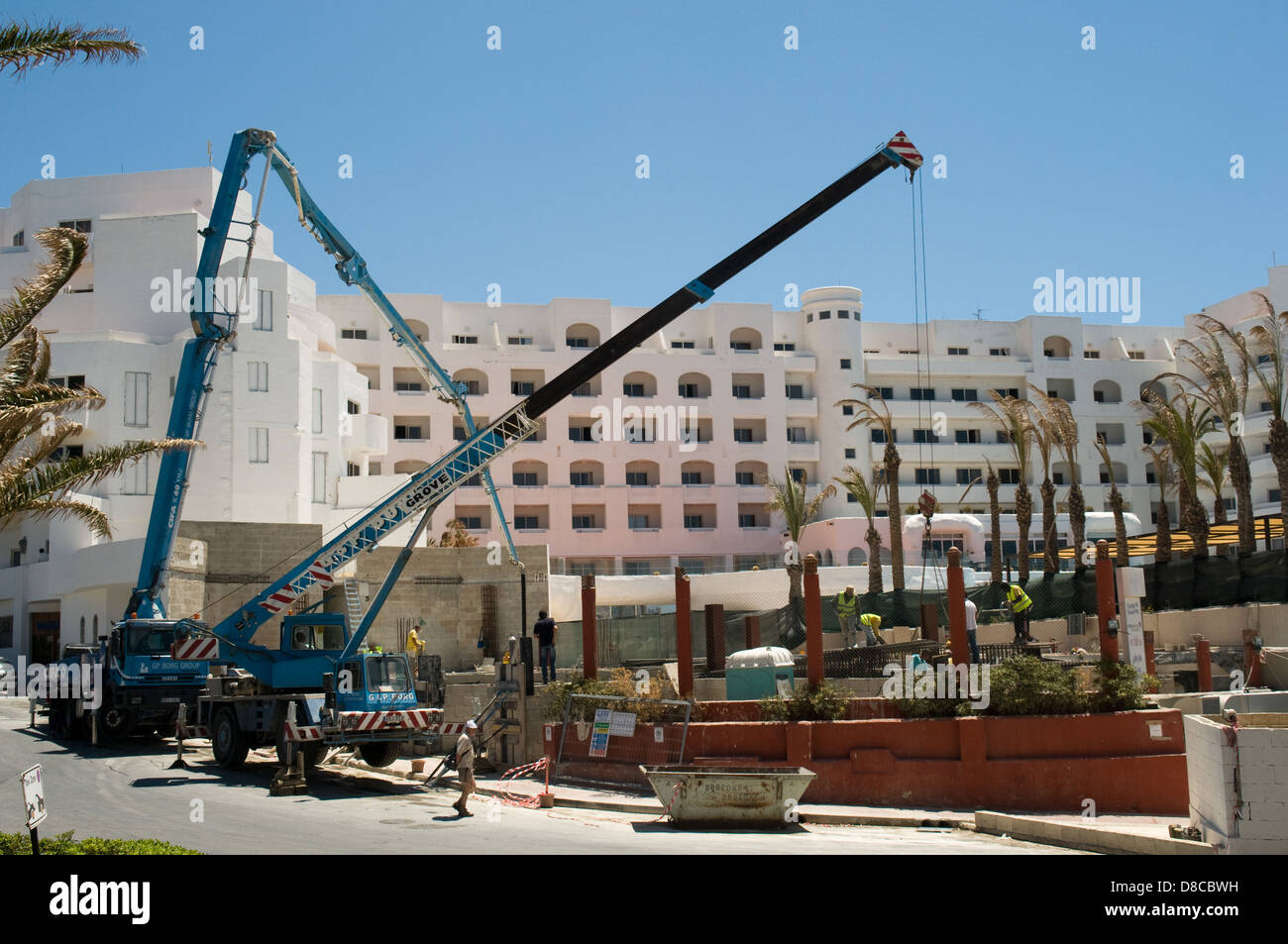 A large hotel in Bugibba Malta has construction work being carried out in its grounds - Stock Image