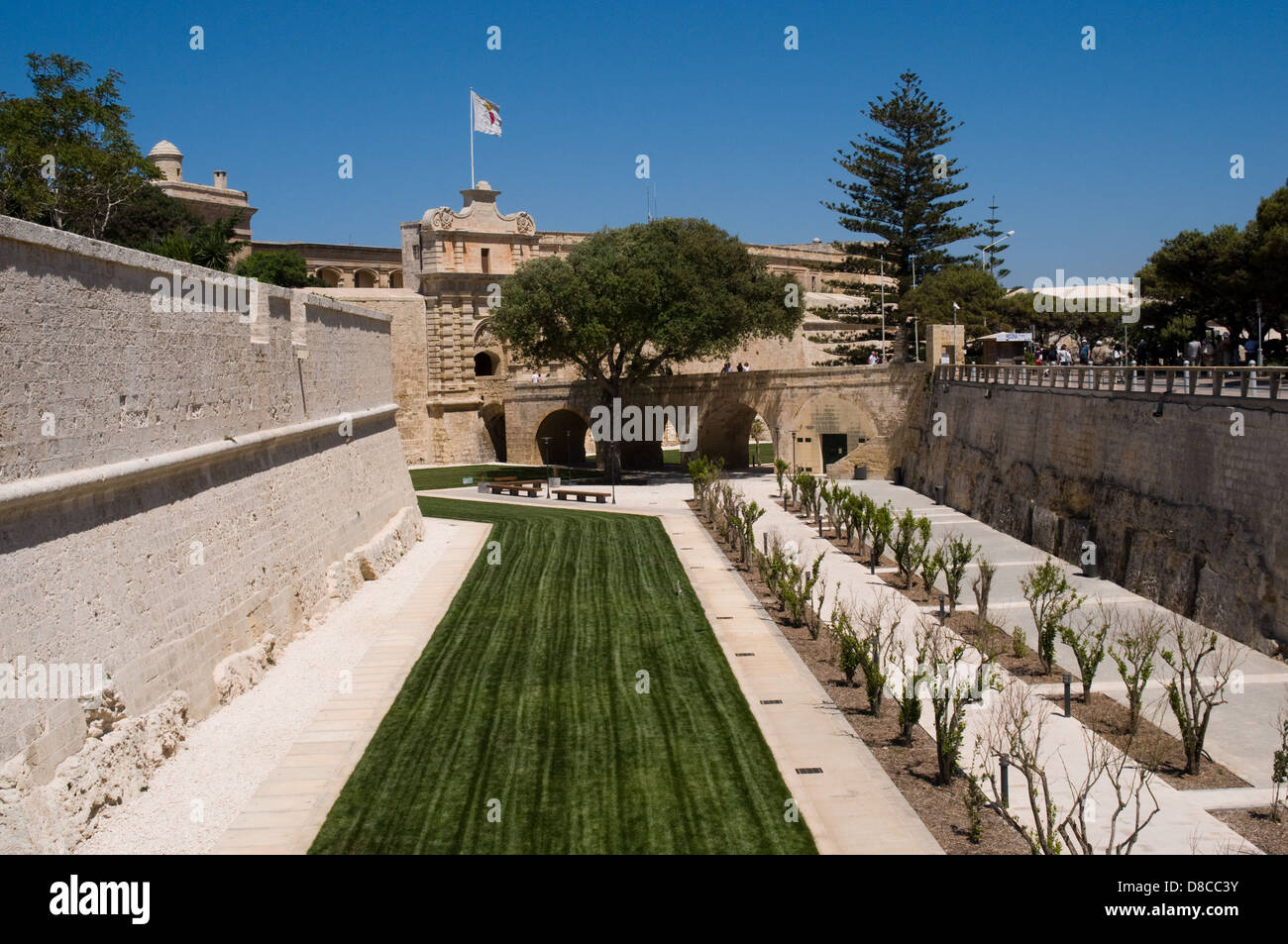 The recently refurbished moat area around the silent city of Mdina Malta. This area used to have an enclosed football - Stock Image