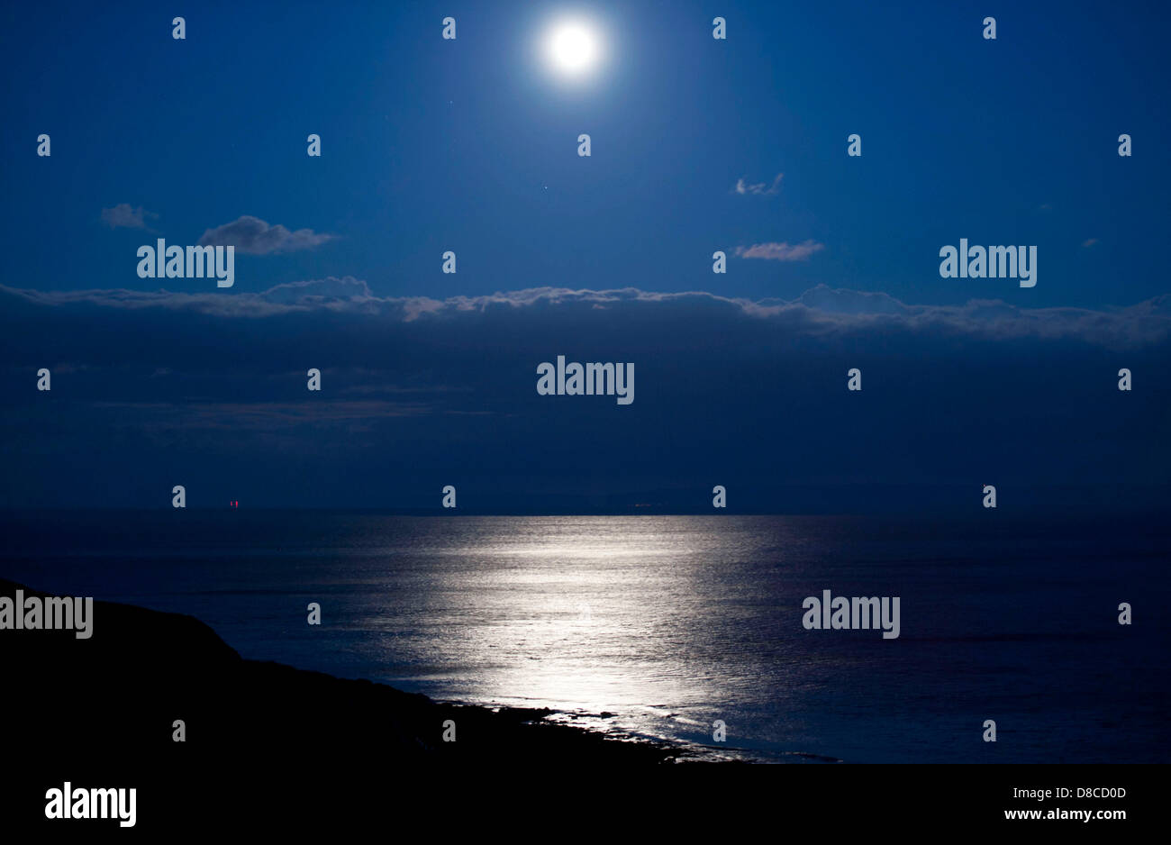 Swansea - UK - 24th May 2013 : Full moon reflecting on the sea at Lambs Well near Langland Bay on the Gower Peninsula, - Stock Image