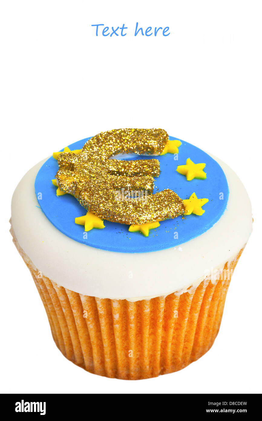 Cupcake decorated with Euro sign and flag. - Stock Image