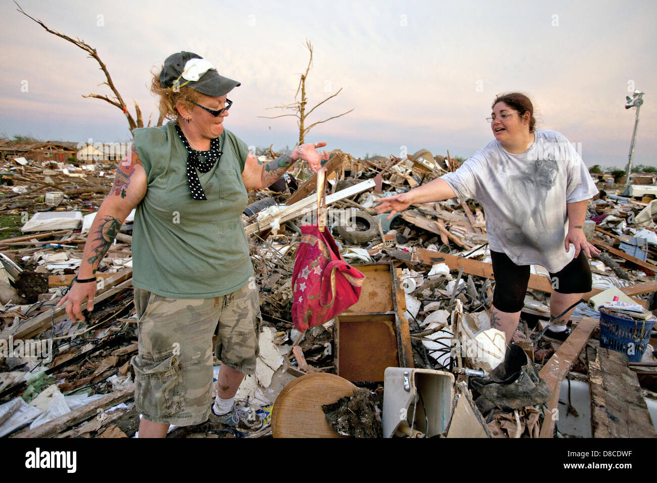 Residents sift through the wreckage of their home in the aftermath of an EF-5 tornado May 22, 2013 in Moore, Oklahoma. - Stock Image