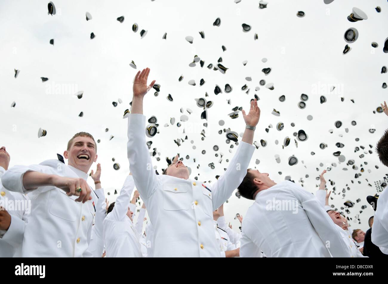 US Naval Academy graduates toss their hats following the Class of 2013 graduation and commissioning ceremony May - Stock Image