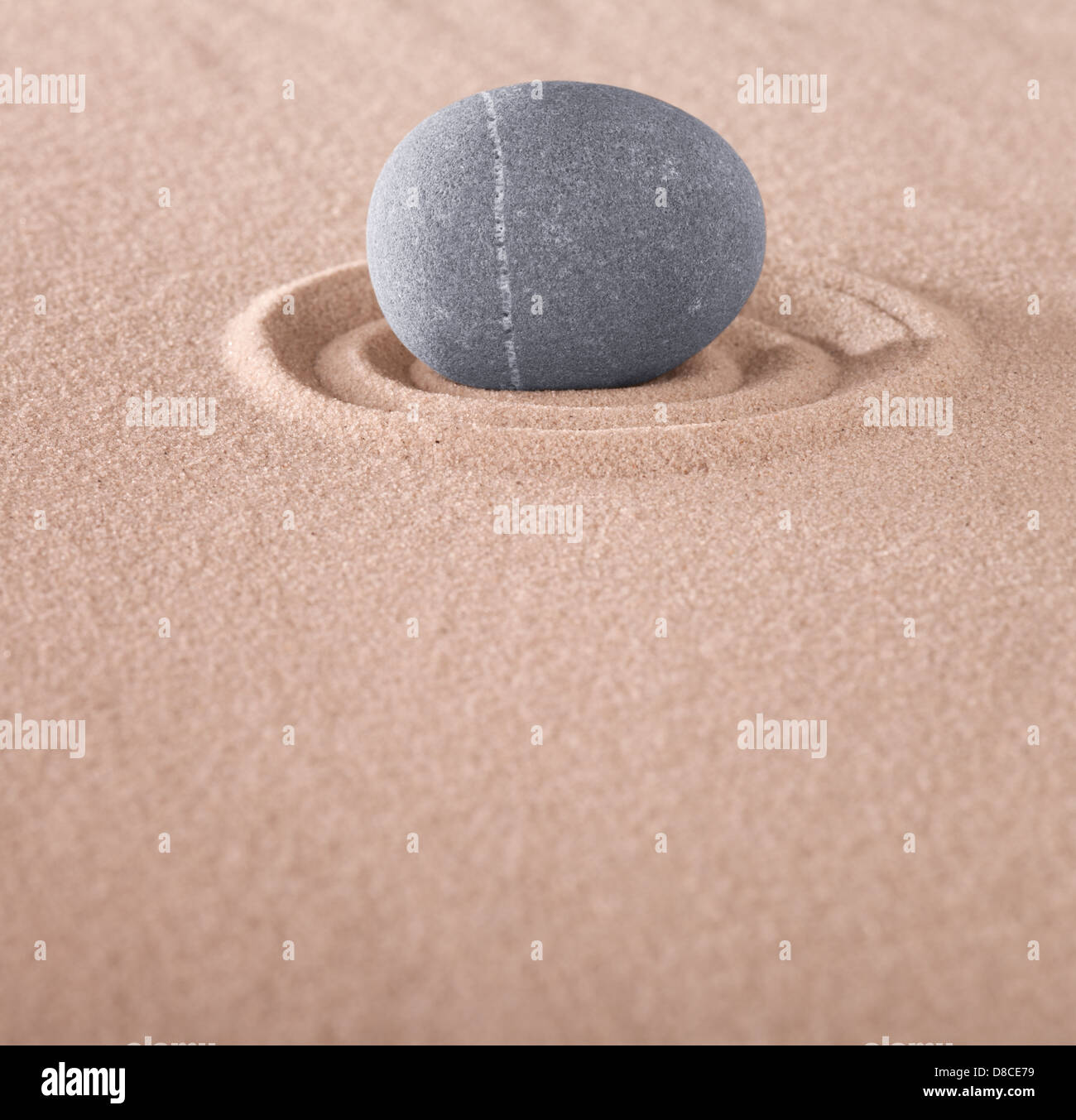 round stone in Japanese zen garden concept for meditation relaxation harmony and meditation - Stock Image