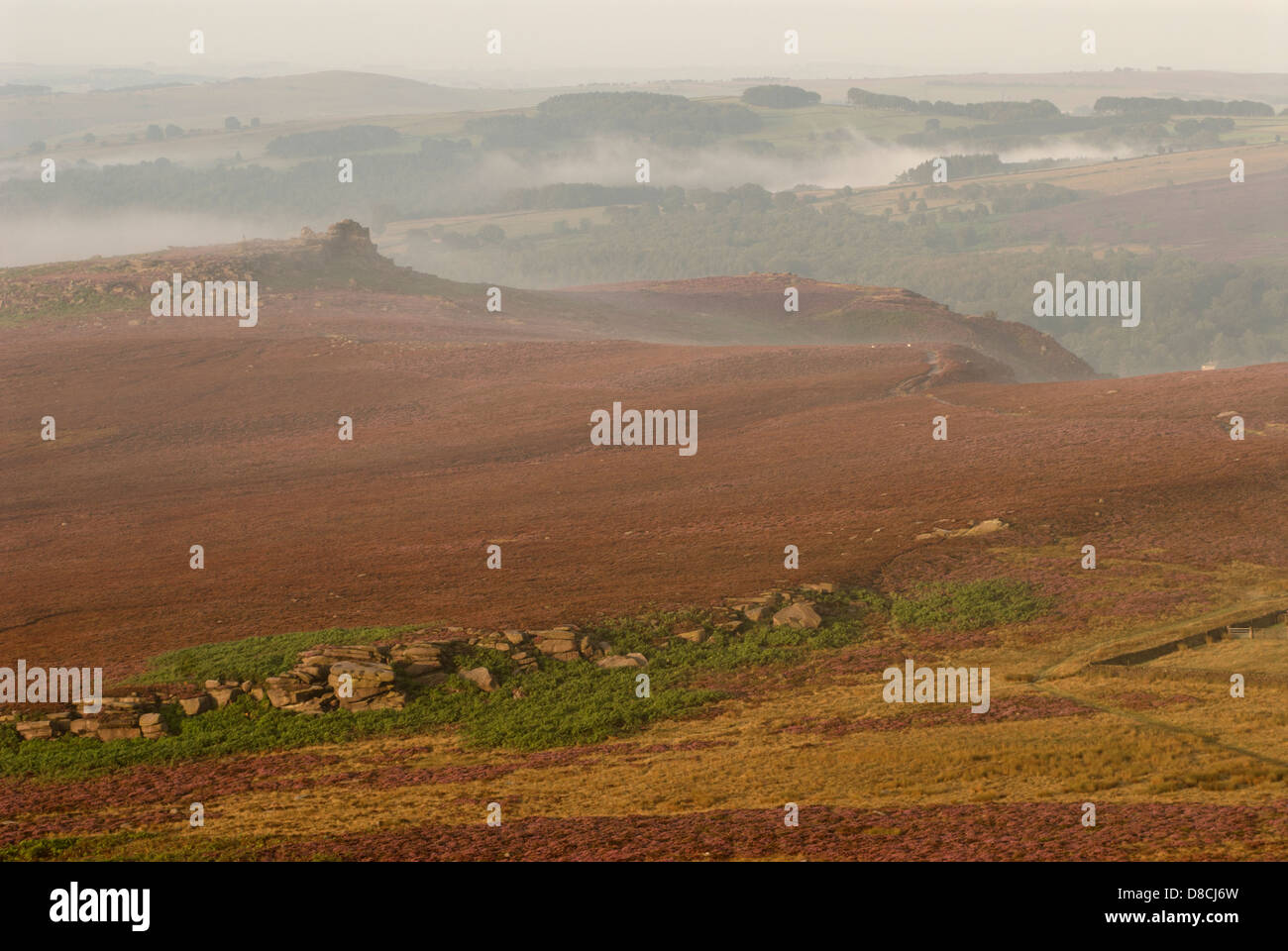 mists swirling around Owler Tor, Derbyshire Peak District - Stock Image