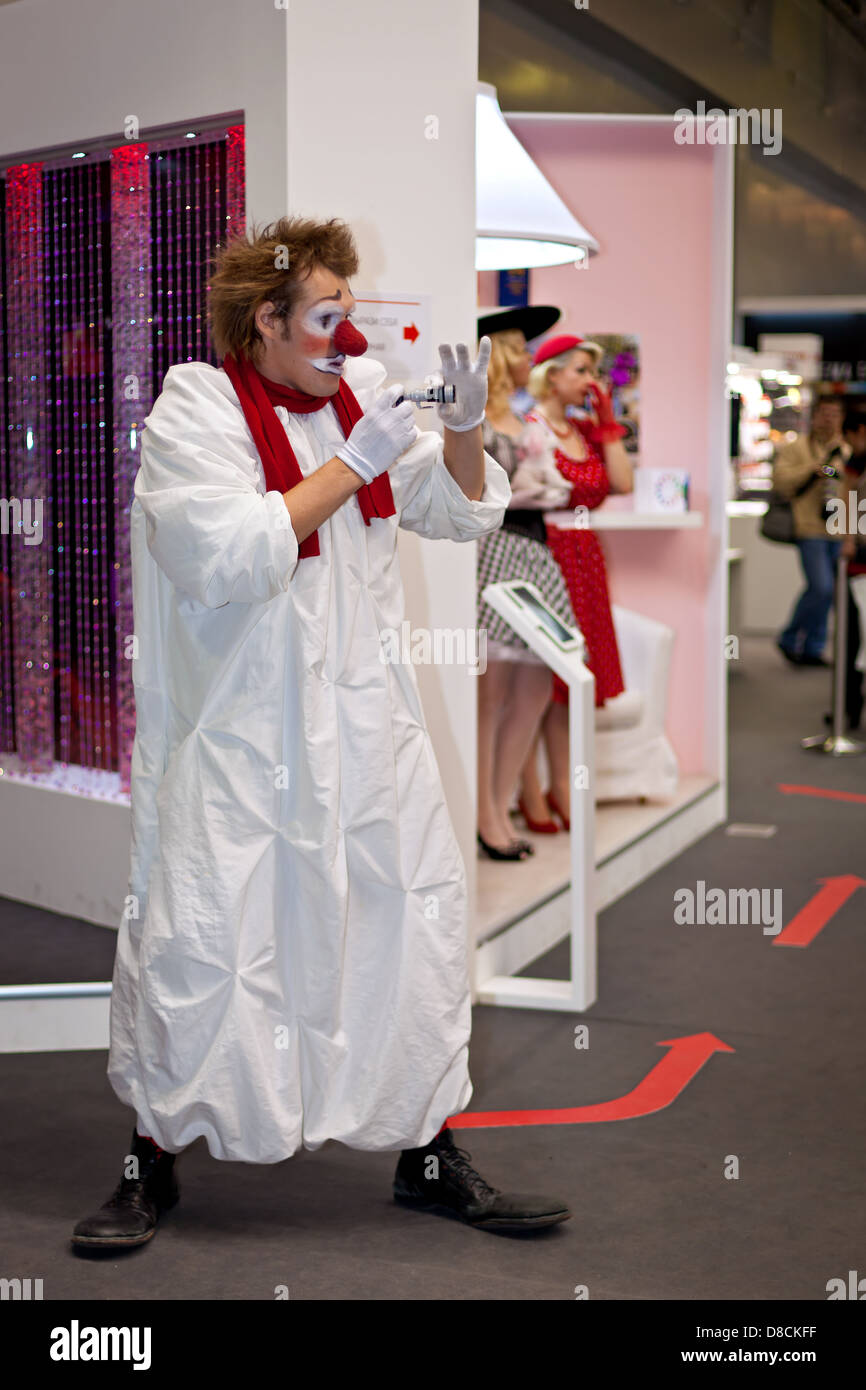 Clown entertaining visitors at Canon stand at Consumer Electronics & Photo Expo, 14th of April 2013 in Moscow, - Stock Image