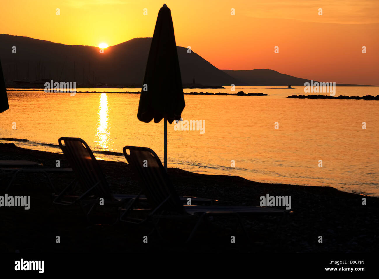 Golden sunset over the hills of Akamas peninsula as seen from Latchi beach, Paphos area, Cyprus - Stock Image