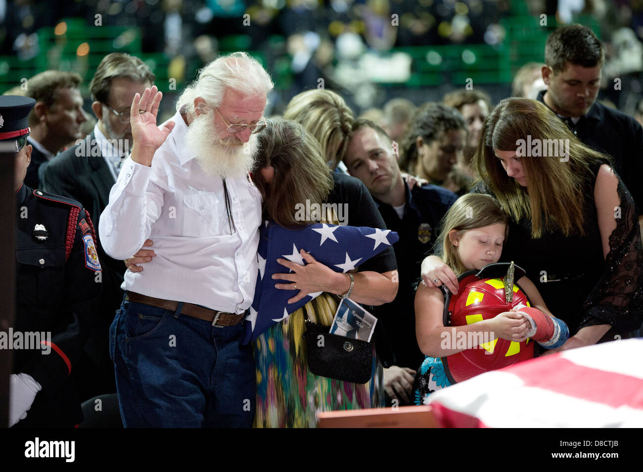 Family members pray during a memorial service for victims of a fertilizer plant explosion in West, Texas, at Baylor - Stock Image