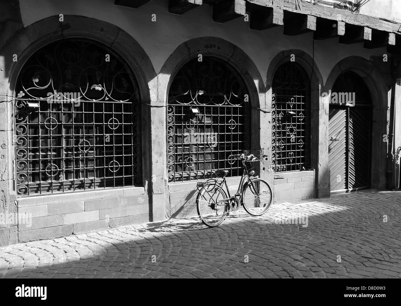 A bicycle parked by a house - Stock Image